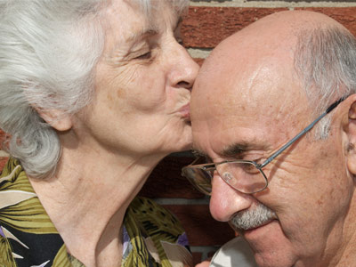 Aging couple kissing