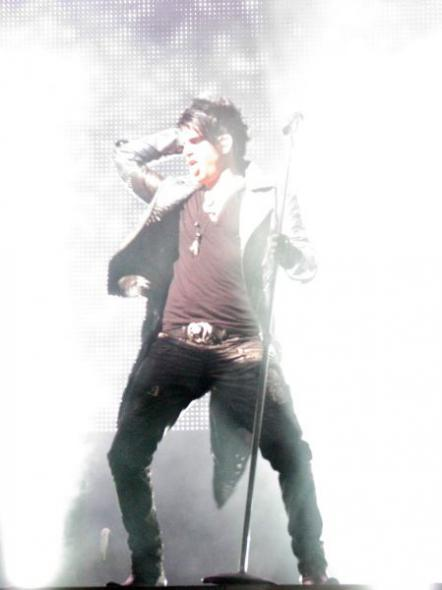 Adam Lambert thrusting his hips