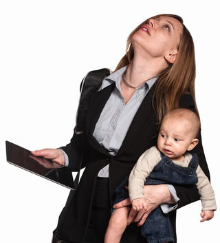 """CREATISTA/Shutterstock, """"Stressed out professional woman with baby over white background,"""" used with permission."""
