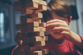 Playing Jenga/ Michal Parzuchowski/ Unsplash/ Licensed Under CC BY 2.0
