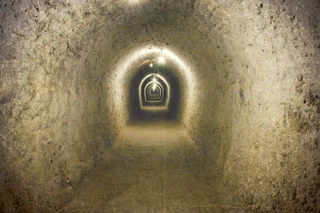 'salajean, 123RF' 'Vintage image of a corridor in an underground salt mine, used with permission.'