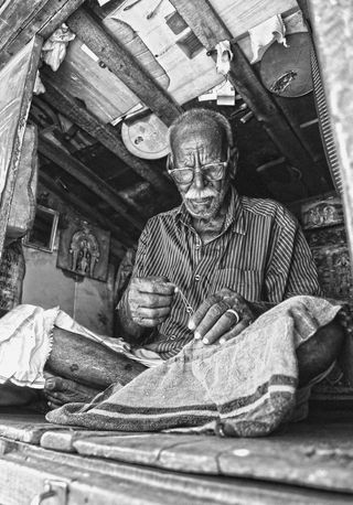 Man at Work/ Vignesh Moorthy/ Unsplash