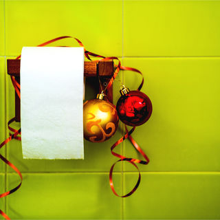 A roll of toilet paper with Christmas decorations.  I By Iuliia Karnaushenko