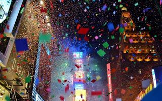 NYE in Time Square/ Gigi NYC/ Flickr/ Licensed Under CC BY 2.0