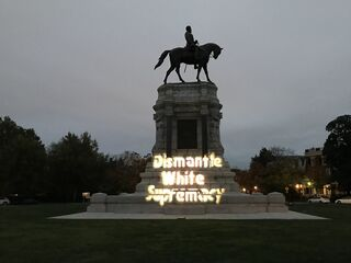 """""""Maryland Solidarity Brigade Projection - Dismantle White Supremacy on General Lee Statue in Richmond VA (Photos courtesy of Richmond DSA)"""" by Backbone Campaign/Licensed under CC BY 2.0"""
