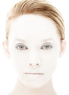 image of a young woman with a white painted face
