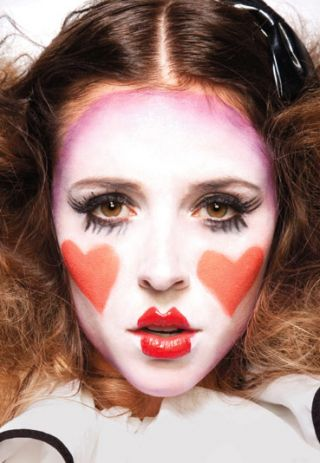 Young woman with mime makeup on