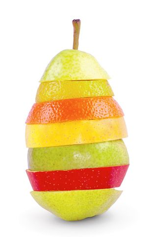Slices  of fruit stacked in a pear shape