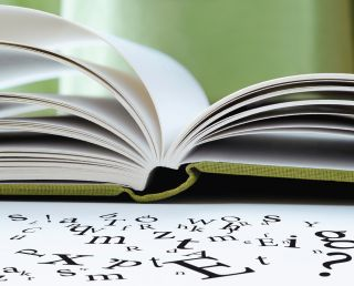 Book with scrambled letters off the pages