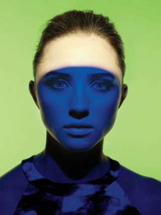 Woman with blue shadow on her face