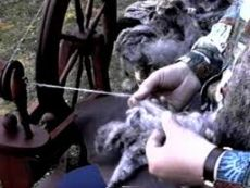 Spinning wool into yarn.