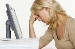 Frustrated woman in front of a computer