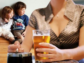Mom drinking beer in front of kids