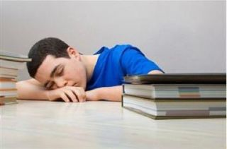 Kid asleep in class.