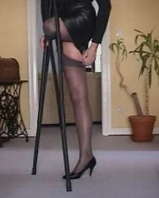 Paraplegic wearing high heels 5