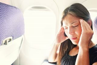 Worried woman on a plane