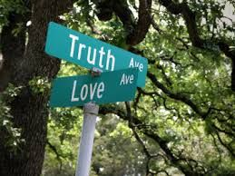 A street sign at an intersection of Truth Street and Love Street.