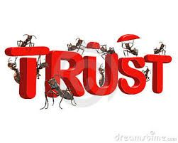 Ants building the word trust out of red material.