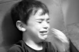small white boy crying in black and white photograph