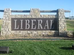 The word liberal written on a sign set in stone.
