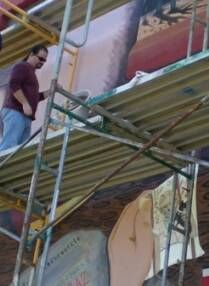 Author working on mural