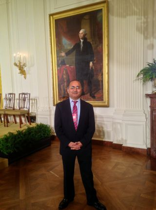 Dr. Dinesh Sharma in the East Room at the WH