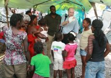 talking with haitian children in tent camps