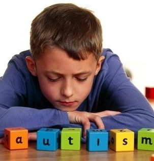 Autism -- Boy with blocks that spell autism