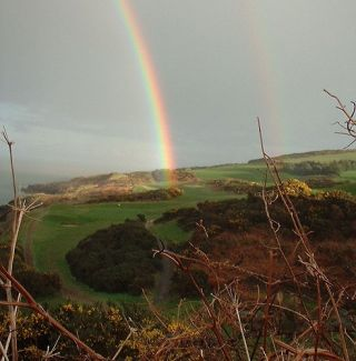 Rainbow on a hillside