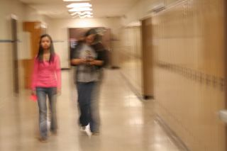 Two girls in a hallway, image distorted and shaky
