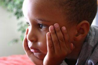 Sad African American child