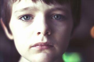 Sad caucasian child.