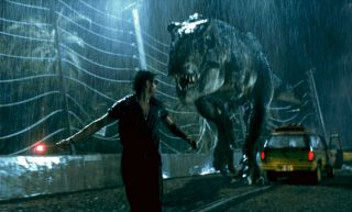 Tyrannasaurus chasing Jeff Goldblum in the movie Jurassic Park
