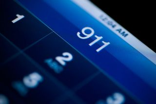 Android cell phone screen displaying the numbers 911