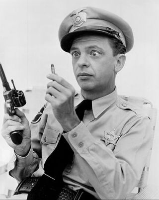 Barney Fife and his gun.