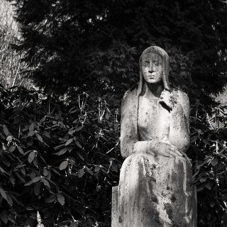 Statue of sad looking woman.