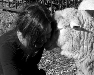 Woman and sheep friend.
