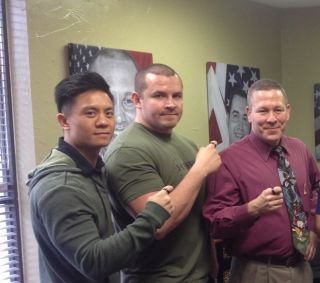 Andy Nguyen, Aaron Throckmorton, Mark Roy display their 22 Kill rings