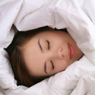 sleeping woman with blanket