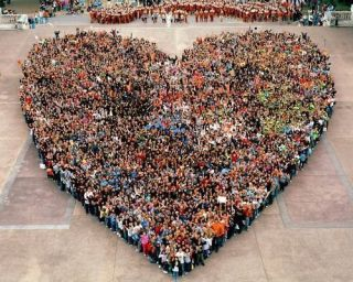 A heart of hundreds of people standing together.