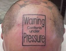 Contents Under Pressure Tattoo on man's head