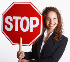 Happy woman holding a stop sign