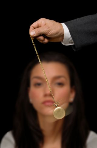 Picture of woman being hypnotized with pocket watch