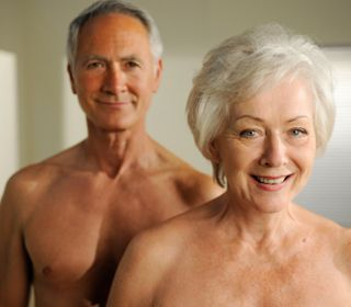 Naked mature spreading