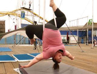 Jennifer Jonassen swinging upside down in her ariel lesson