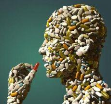 Human made of pills taking a pill
