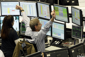 Stock broker cheering as stocks rise