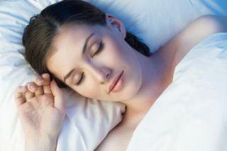 Woman sleeping comfortably in bed