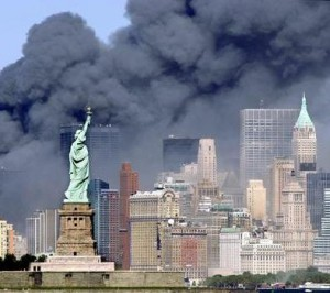 WTC burns behind the Statue of Liberty