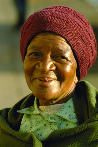 an older African woman savors life